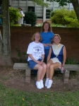 McCorvey family girls in courtyard (seated:  Diane '68, Gail '73, majorette, standing: Jennie M. Fleming '72, also ma